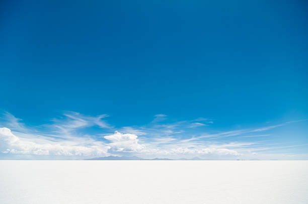 Salar de Uyuni Salar de Uyuni, Bolivia. One of the most spectacular landscape on Earth. horizon over land stock pictures, royalty-free photos & images