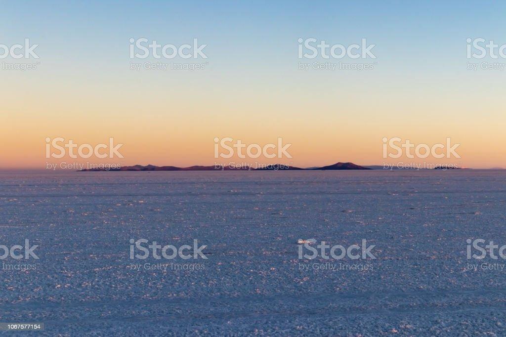Salar De Uyuni Salt Flat Panorama At Sunset In The Altiplano