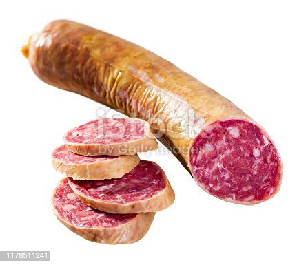 Salchichon spanish sausage slices, view from top. Isolated over white background
