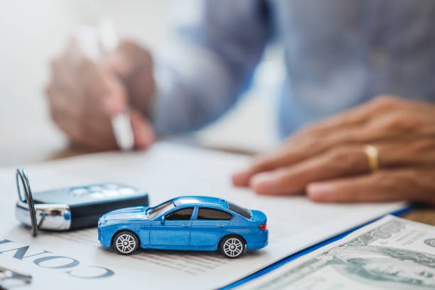 Sale agent  deal to agreement successful car loan contract with customer and sign agreement contract  Insurance car concept. stock photo