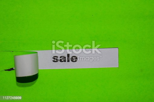 1136804881 istock photo Sale, business concept on green torn paper 1127245939