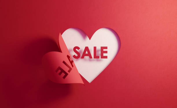 Sale Concept- Sale Text Inside Of A Red Folding Heart Shape On White Background Sale text inside of a red folding heart shape on white background. Horizontal composition with  copy space. Sale concept. cheap stock pictures, royalty-free photos & images
