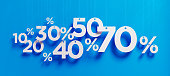 "Percentage signs with white strings over blue background. Horizontal composition with copy space. Great use for shopping and Valentine's Day Christmas and Mother""s Day related concepts."