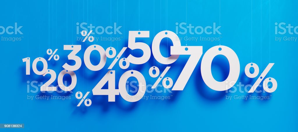 Conceito de venda - sinais de porcentagem de branco sobre fundo azul - foto de acervo