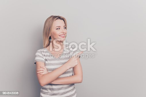 Sale discount feedback person people concept. Close up portrait of confident  friendly good-looking woman Pointing aside on empty blank place with forefinger over shoulder isolated on gray background