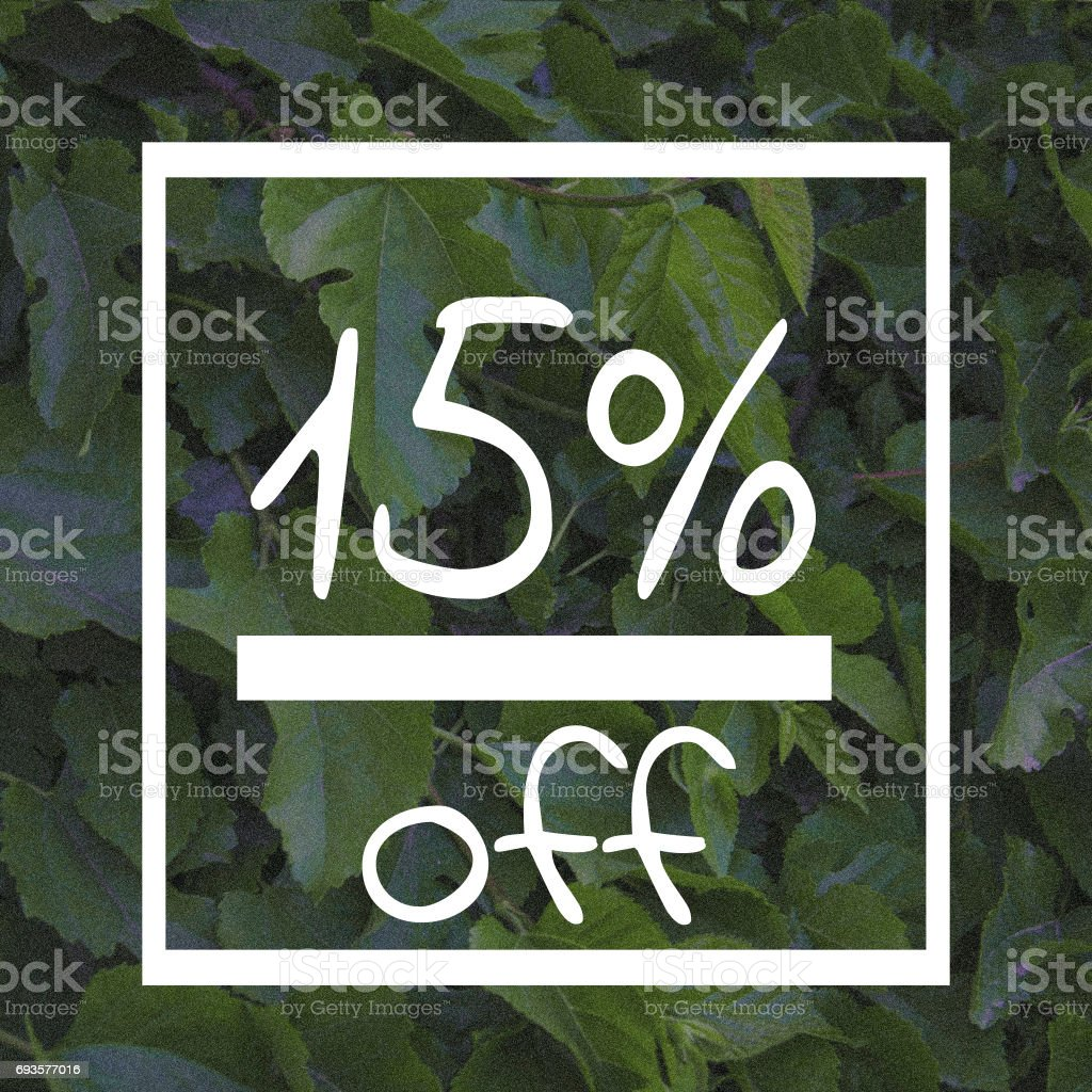 Sale fifteen percent off sign on green leaf background stock photo