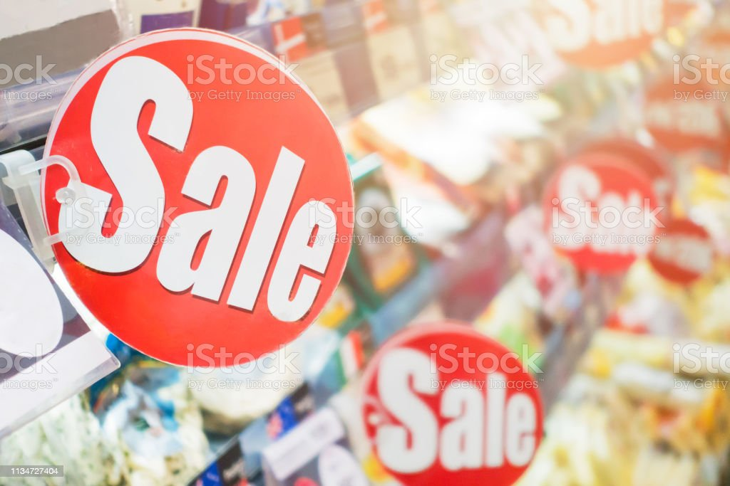 sale labels reduce price in the supermarket stock photo