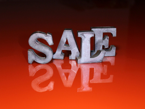 Sale Metal Letters On Red Surface Stock Photo - Download Image Now