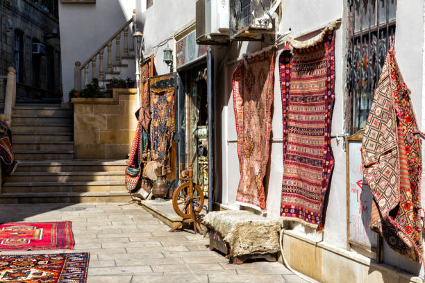 Sale of antique carpets on the streets of the Old City of Baku. Azerbaijan stock photo