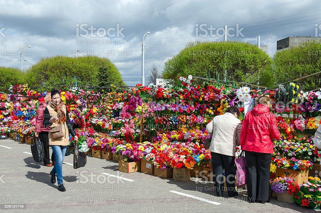 Sale of artificial flowers on Prudkovskii market, Gomel, Belarus stock photo