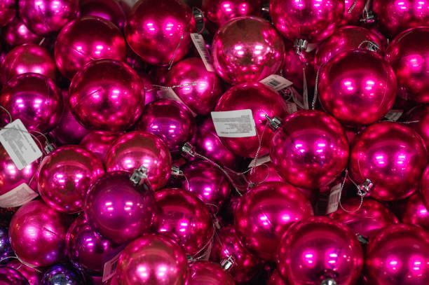 Sale of Christmas toys in the supermarket. Balls of different colors for the Christmas tree on the supermarket shelves. stock photo