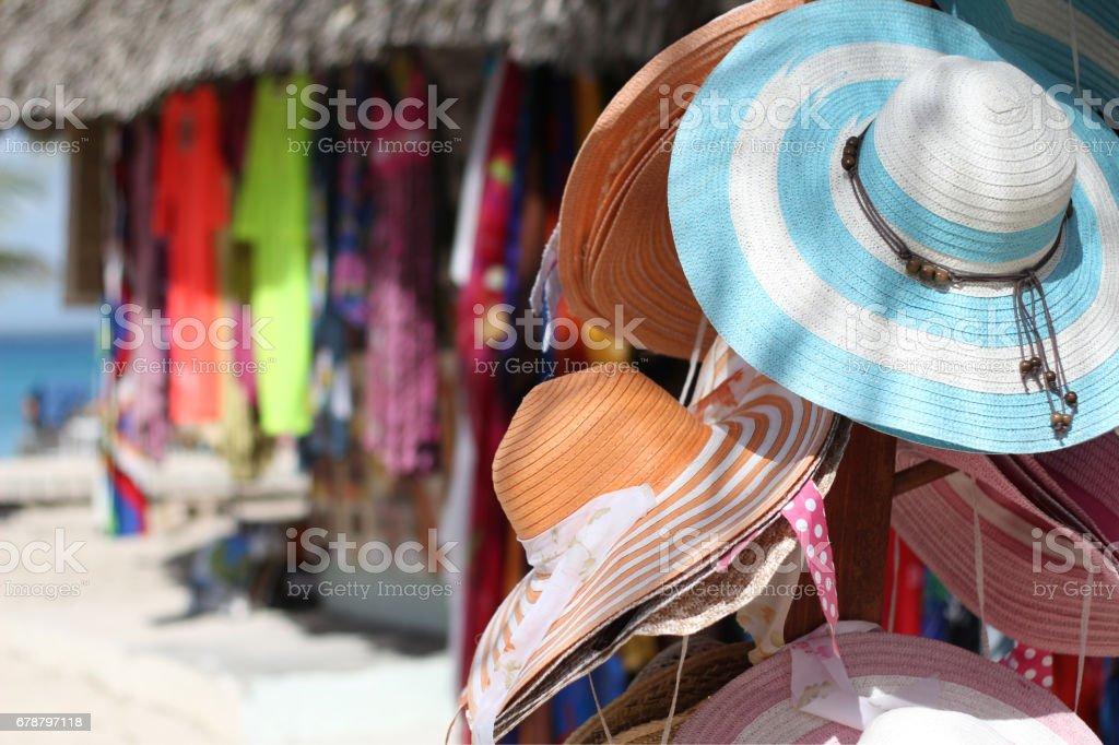 Sale of handmade hats and clothes in a beach market stock photo