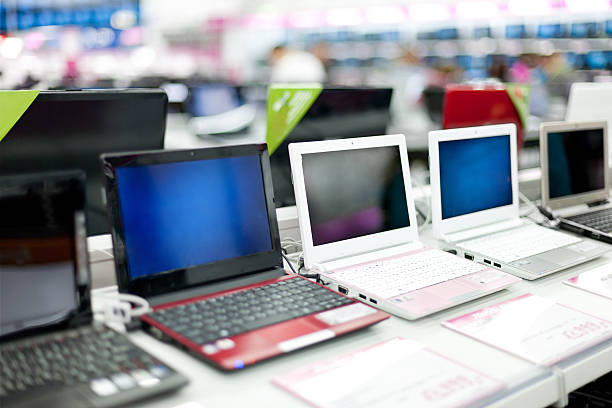 Sale of laptops in shop stock photo