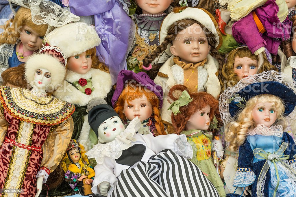 Sale of old dolls at a flea market stock photo