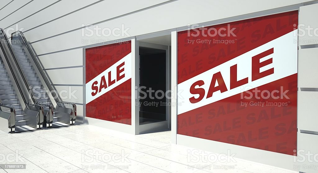 Sale on shopfront windows and escalator royalty-free stock photo