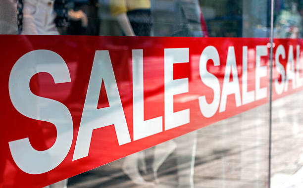 Sale Picture of shop window display with text Sale on red poster miserly stock pictures, royalty-free photos & images