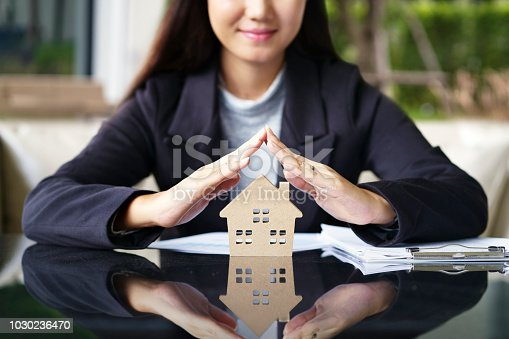 istock Sale represent real estate agent offer new house, document loan contract and insurance, success business contract deals. 1030236470