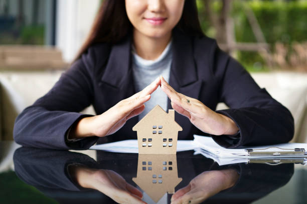 Sale represent real estate agent offer new house, document loan contract and insurance, success business contract deals. Sale represent real estate agent offer new house, document loan contract and insurance, success business contract deals. home insurance stock pictures, royalty-free photos & images