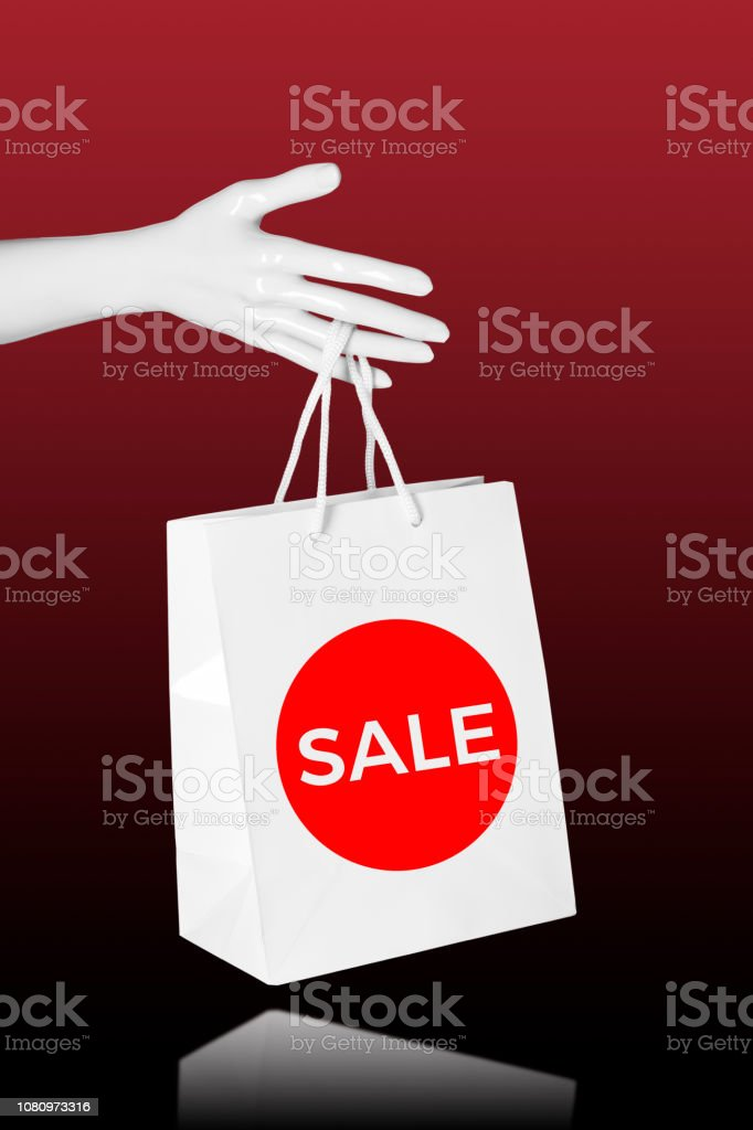 Sale shopping concept. Mannequin Hand with shopping bag. stock photo