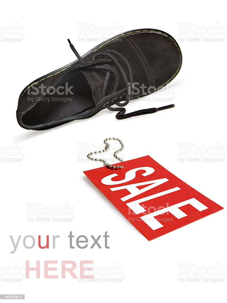 Sale sign and shoe with clipping path royalty-free stock photo