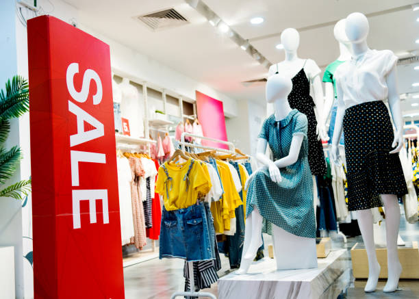 Sale sign at the entrance of clothing store Sale sign at the entrance of clothing store. discount store stock pictures, royalty-free photos & images