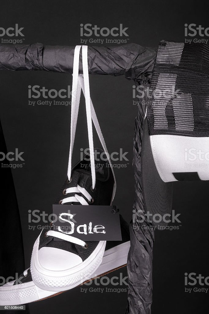 Sale sign. Black and white sneakers, cap  hanging foto stock royalty-free