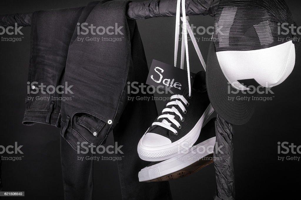 Sale sign. Black friday.  and white sneakers, cap  pant photo libre de droits
