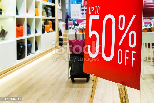 Sale sign in luggage store.