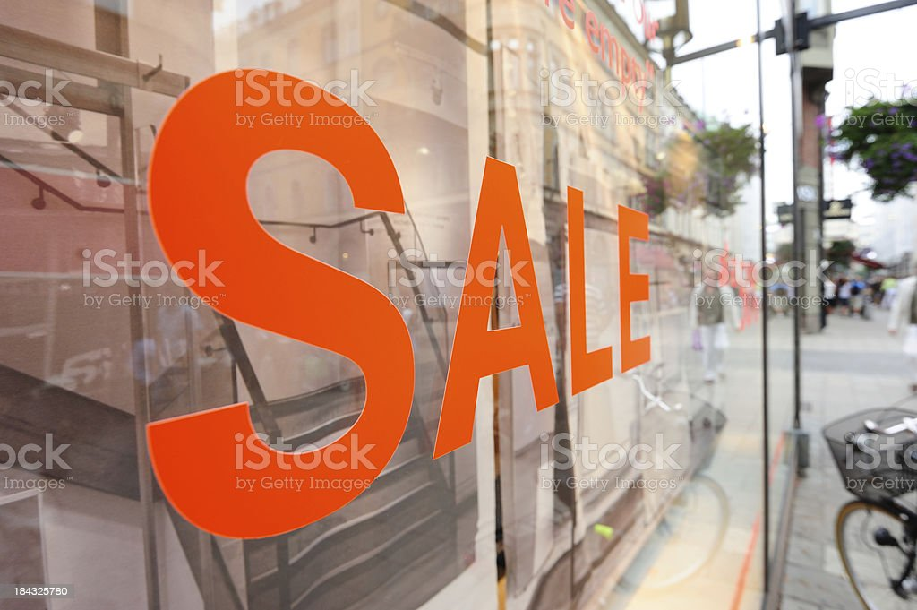 Sale sign in shop window stock photo