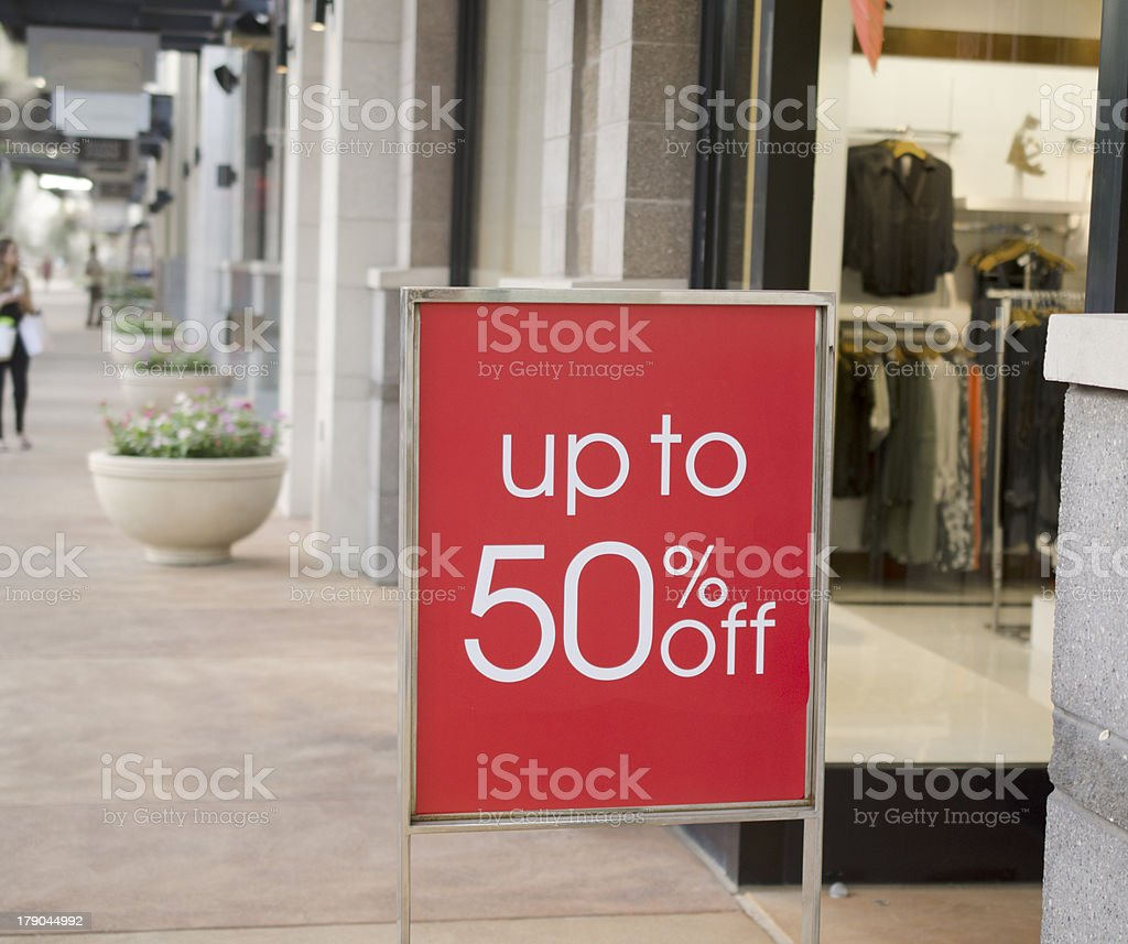 Sale sign outside fashion retail store in shopping mall royalty-free stock photo