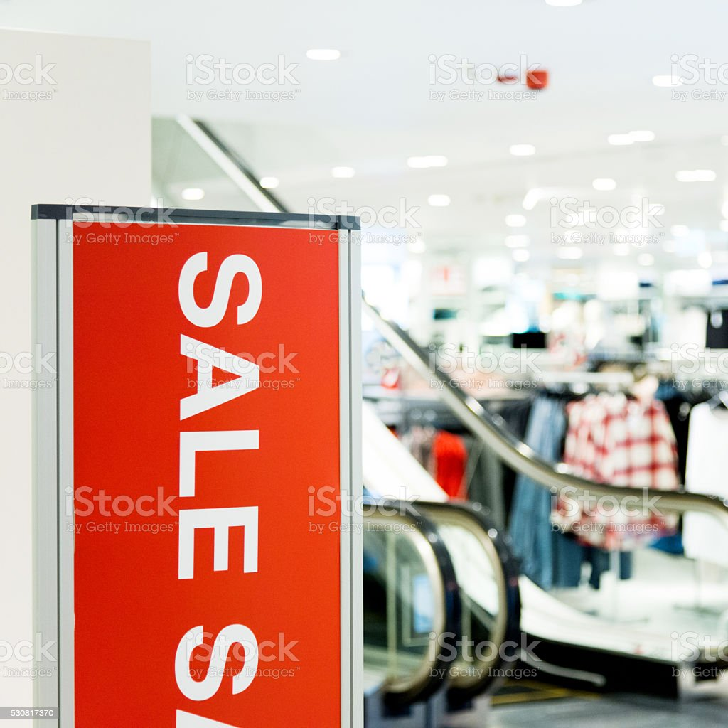 Sale signs in a fashion store.
