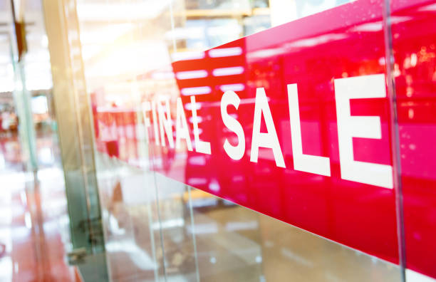 Sale signs in shopping mall store window Sale signs in shopping mall store window. discount store stock pictures, royalty-free photos & images