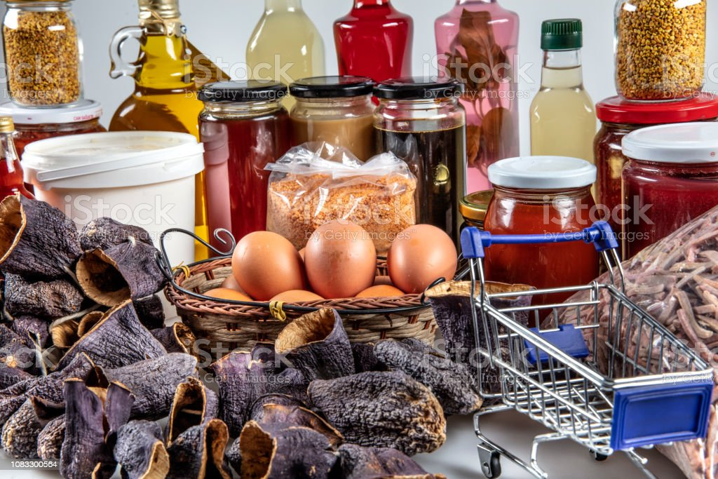 Sale stand consisting of local organic products, eggs, honey, vinegar, salca, butter, dry eggplant. stock photo