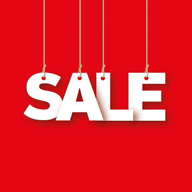 Sale, the word of the letters hanging on the ropes stock photo