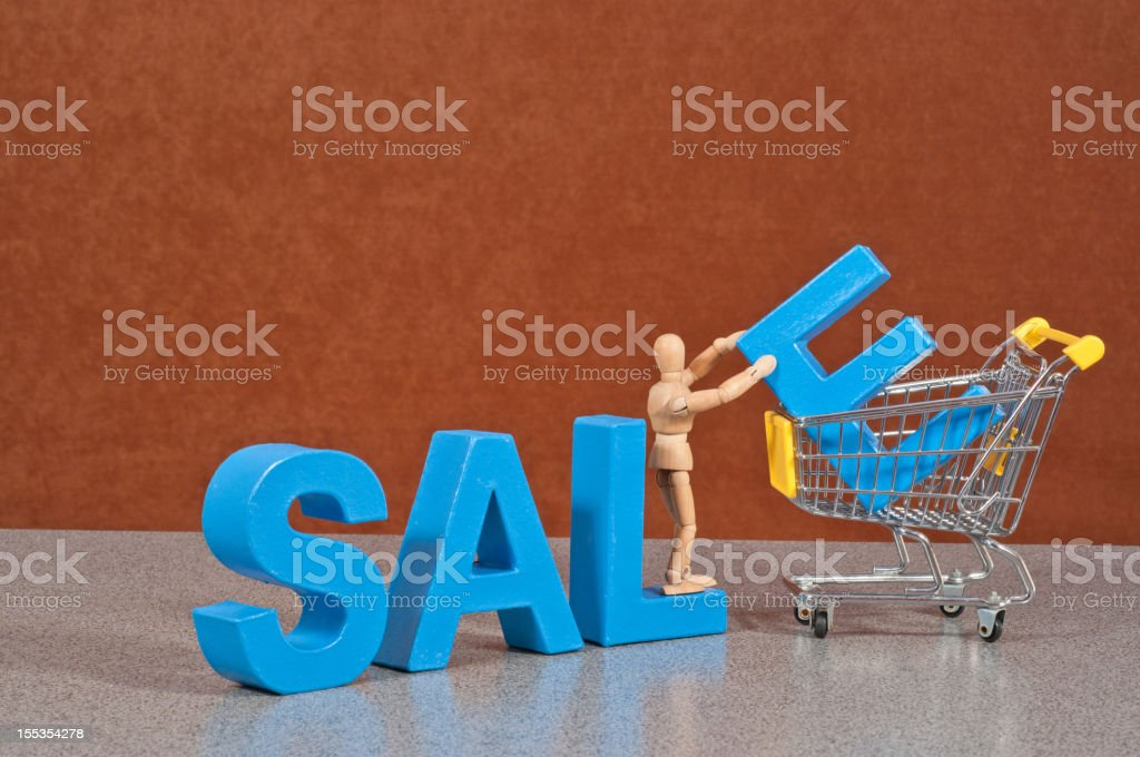 Sale - Wooden Mannequin demonstrating this word stock photo