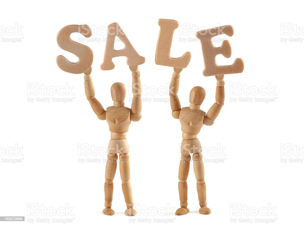Sale - wooden mannequin holding this word stock photo