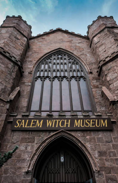 salem, ma, usa - september 27 2016: gothic styled building and entrance for a popular tourist attraction as seen in salem, ma. - curator stock pictures, royalty-free photos & images