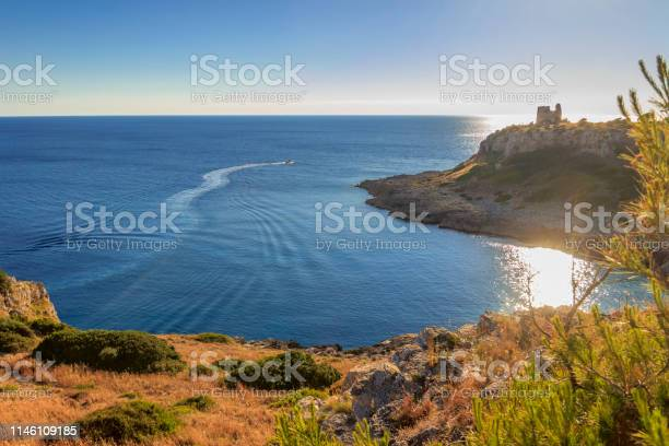 Photo of Salento coast: view of Uluzzo Bay with watchtower . - ITALY (Apulia) -Regional Natural Park Porto Selvaggio and Palude del Capitano is rocky and jagged, with pine forests and Mediterranean scrub.