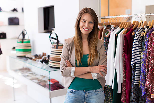 Sales assistant in clothing store Sales assistant in clothing store sales clerk stock pictures, royalty-free photos & images
