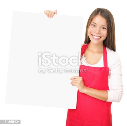 istock Sales clerk showing blank sign 134365404