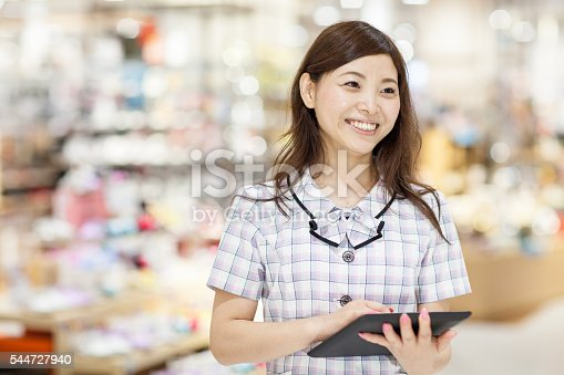 istock Sales clerk using a digital tablet in a department store 544727940