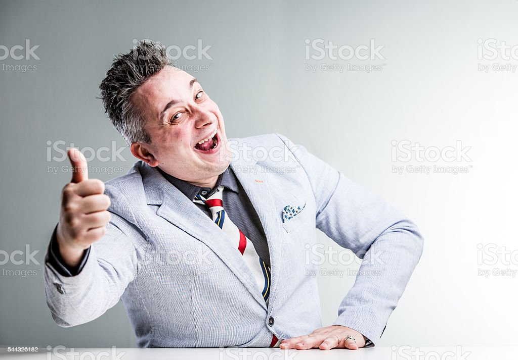 sales con artist showing thumb up stock photo