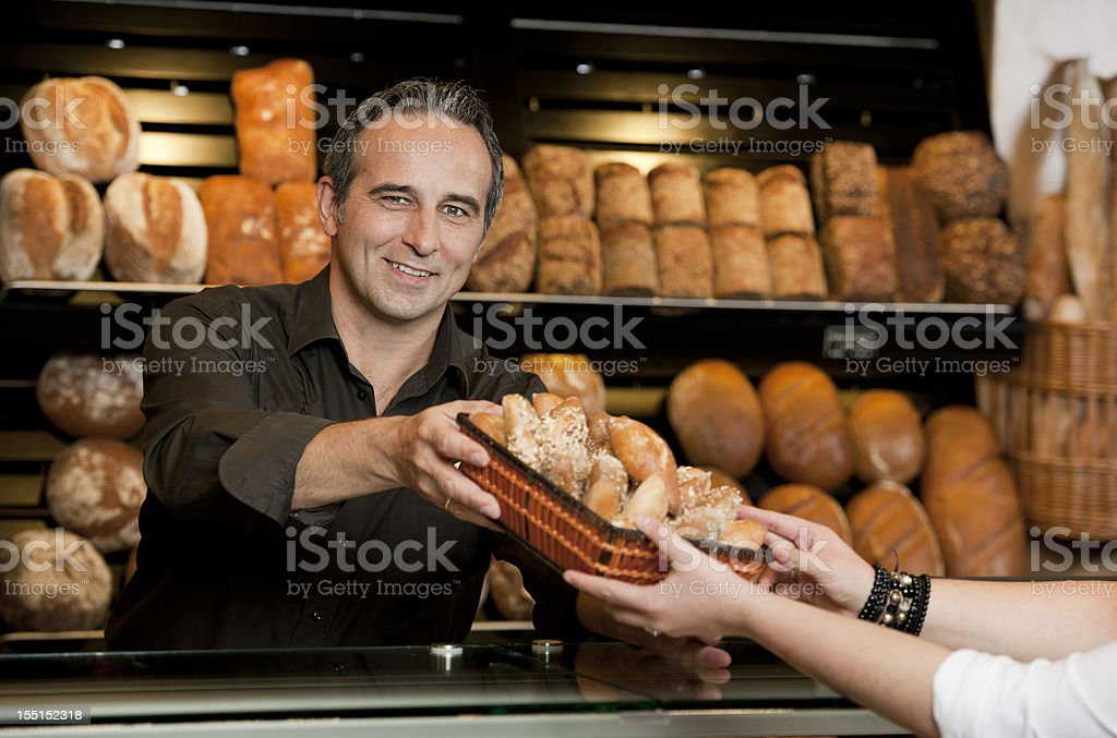 Sales executives selling bread in bakery royalty-free stock photo