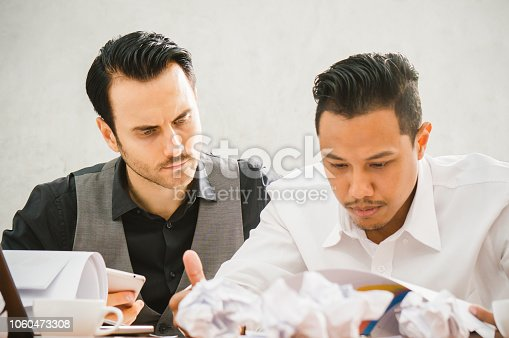 690496350istockphoto Sales man stress because he cannot meet target of this month 1060473308