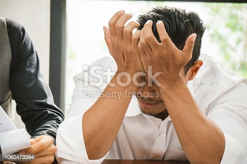 690496350istockphoto Sales man stress because he cannot meet target of this month 1060473394