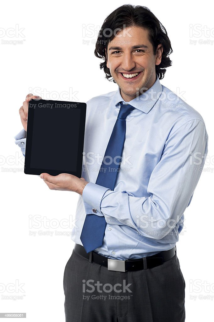 Sales manager displaying newly launched tablet pc royalty-free stock photo