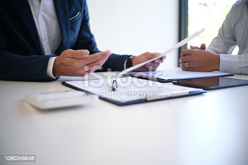 istock Sales manager giving advice application form document, considering mortgage loan offer for car and house insurance. 1090346648