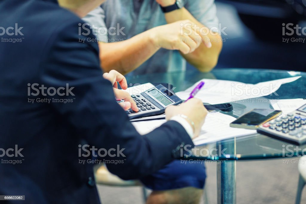 sales manager giving advice to his clients stock photo