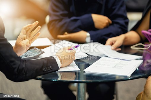 istock sales manager giving advice to his couple clients 656623434