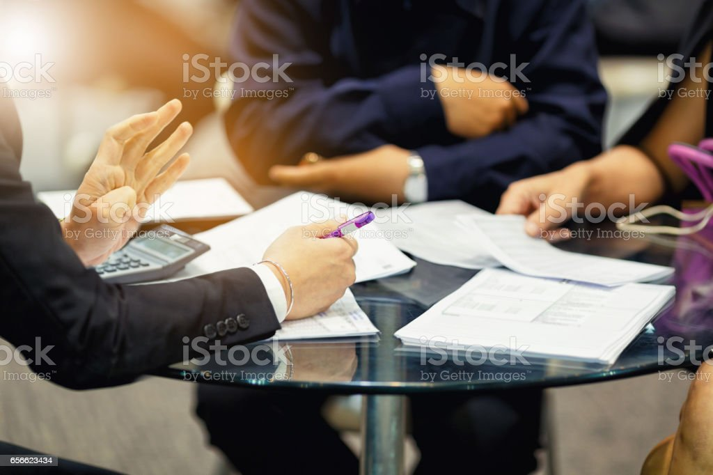 sales manager giving advice to his couple clients stock photo